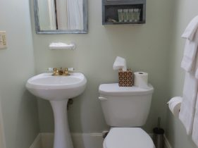 Bathroom for Room 2 and 3 featuring pedestal sink