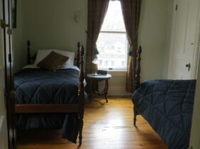 Second bedroom of the Suite. This room contains two twin beds and armoire.