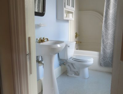 Bathroom in Room 5 featuring pedestal sink and tub-shower combination