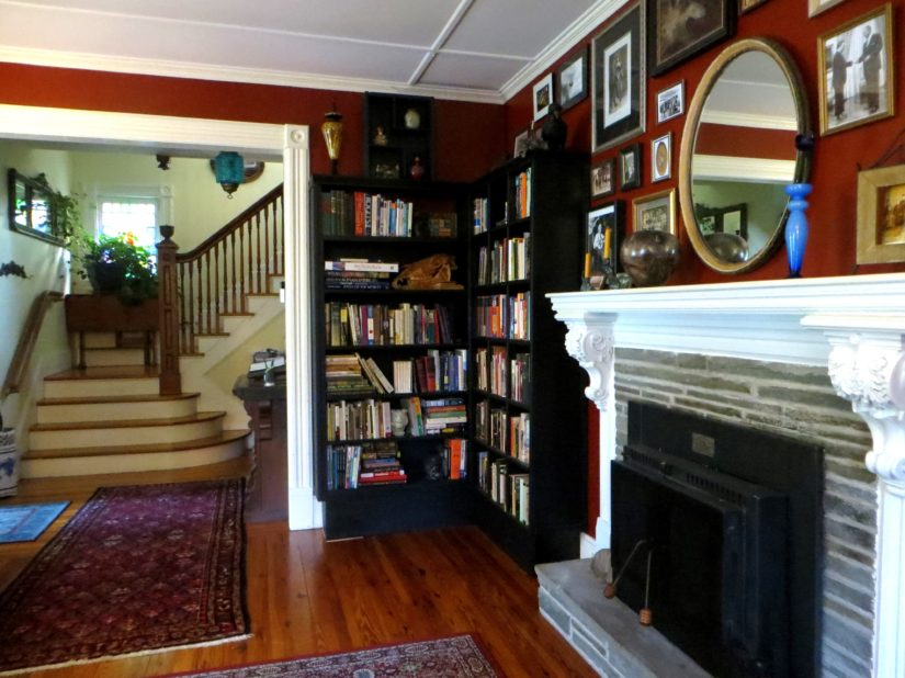 Living Room with books on shelves and fireplace